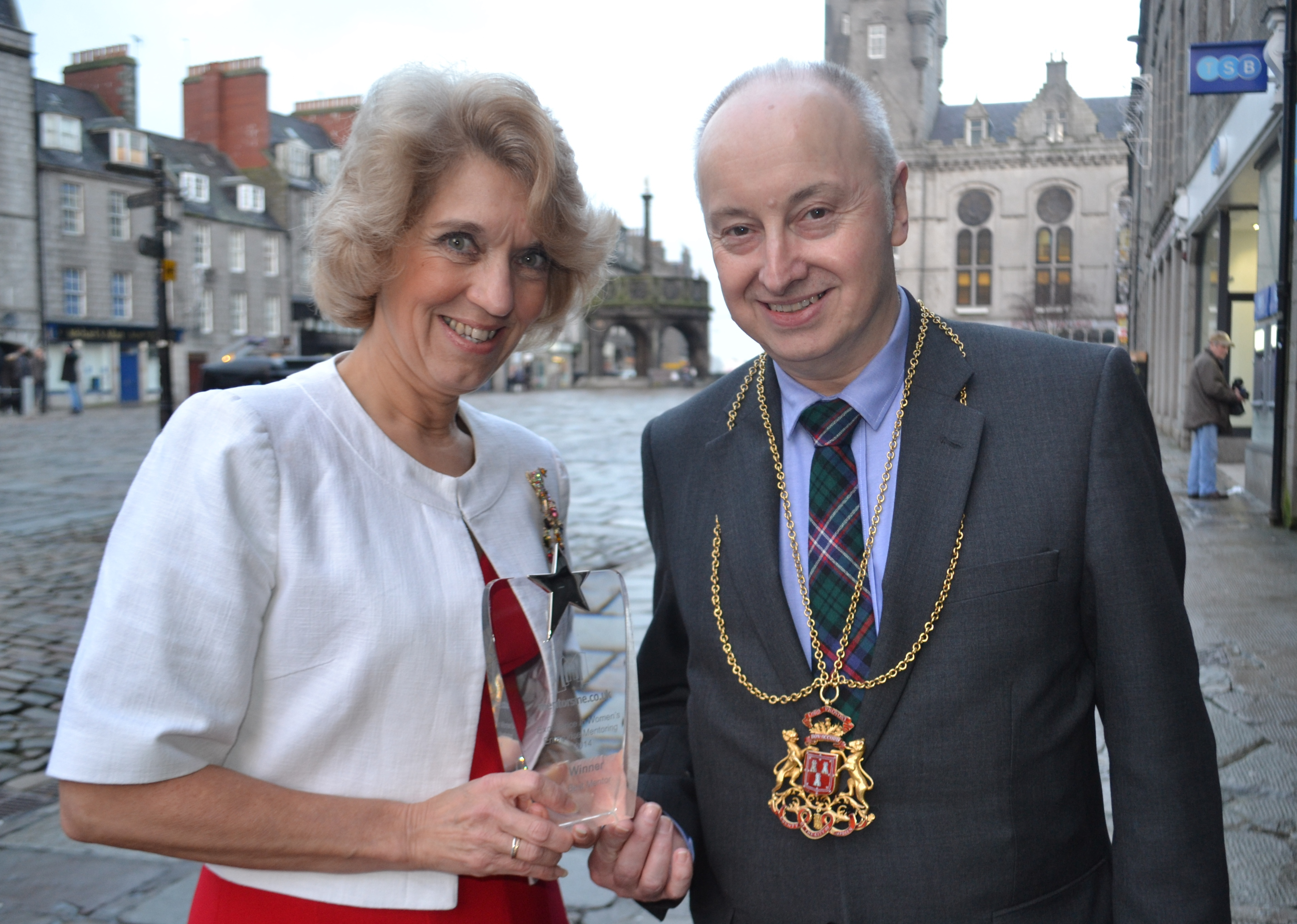 Jeanette Forbes, CEO of the PCL Group with Lord Provost George Adam with the Best Mentor Award which Jeanette won in the British Chambers of Commerce Excellence in Women's Enterprise Mentoring Awards in London